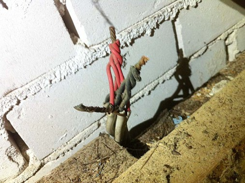 Bare wires in roof space