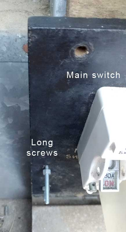 Two faults here, long screws, and non-compliant main switch