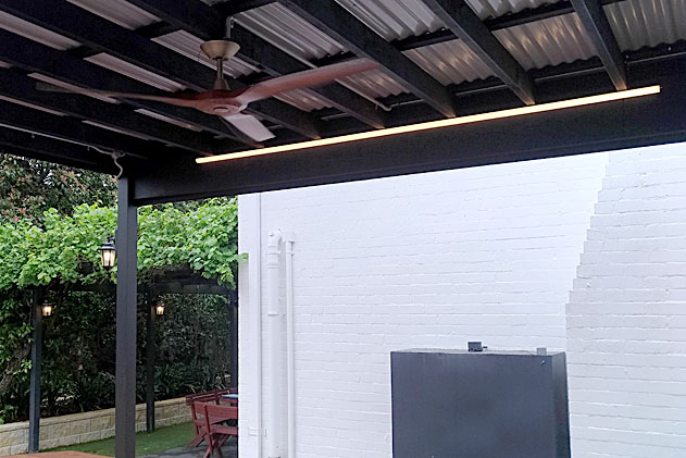 Strip lights and fan under a pergola